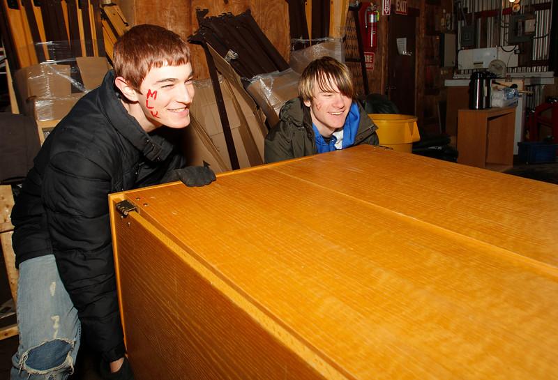 BGSU Freshmen Ryan Hersh and Tanner Zizelman help organize furniture at the Ridge Street Warehouse for the MLK Service Day.