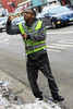 BGSU student helps remove lights from trees on Main Street