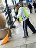 BGSU Student, David Denison helps shovel snow off of Main Street sidewalk