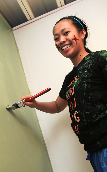 BGSU Student Princess Benedicto helps paint the walls at the American Red Cross