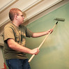 BGSU Student Joshua Dean helps finish painting this wall at the American Red Cross
