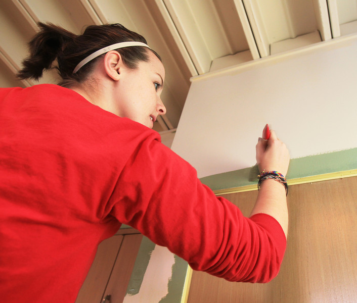 BGSU Student Karrie Barbie helps paint the walls at the American Red Cross