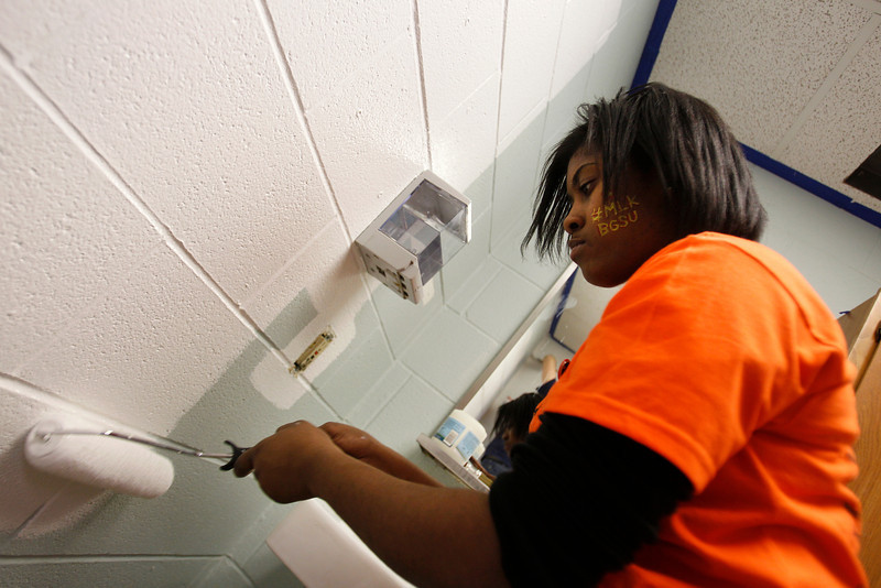 BGSU Junior Raisa Mathis paints a portion of the Wood County Humane Society as part of the MLK Service Day.
