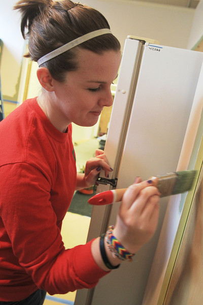 BGSU Student Karrie Barbie helps paint the walls of the kitchen at the American Red Cross
