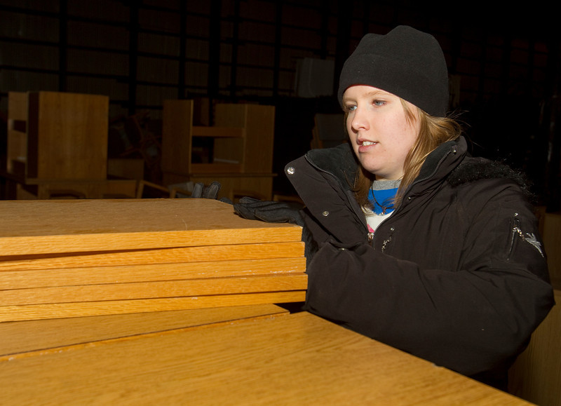 BGSU Junior Victoria Recker helps organize furniture at the Ridge Street Warehouse for the MLK Service Day.