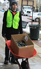 BGSU Student Adam Roberts uses wheel barrel to transport box for light removal