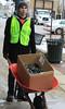 BGSU Student Adam Roberts uses wheel barrel to transport box for light removal