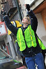 BGSU Student Sara Harden helps remove lights from holiday decorations on Main Street