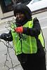 BGSU Student Angel Edwards helping remove lights from trees on Main Street