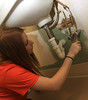 BGSU Student Sara Adams helps paint the walls at the American Red Cross