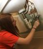 BGSU Student Sara Adams helps paint the walls at the American Red Cross