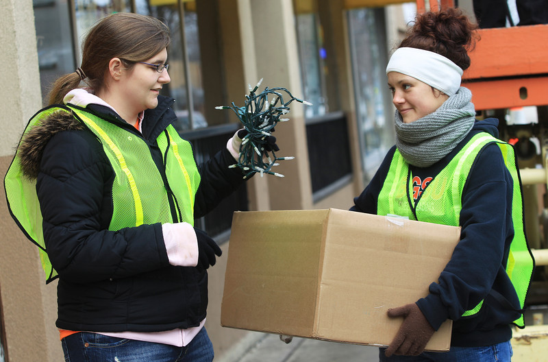 BGSU Students Christina Green and Jenni Troyer help put away holiday lights from Main Street
