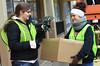 BGSU Students Christina Green and Jenni Troyer help put away holiday lights from Main Street