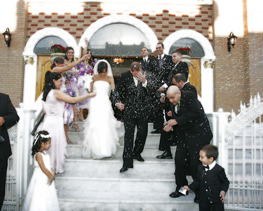 Throwing the Rice. Greek Wedding Photography by Maria Tolios, NYC, Astoria, Bayside, Whitestone, Brooklyn, Manhattan, Long Island, Queens, Nassau County.