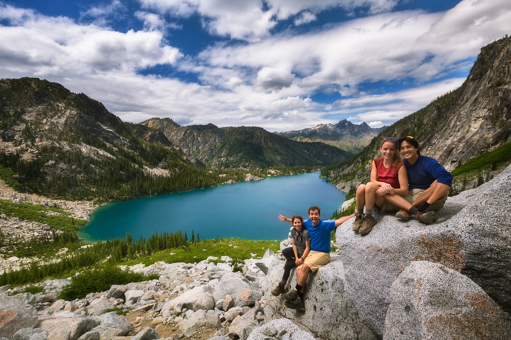 Photo of hikers on asgard pass overlooking colchuck lake in the enchantments, washington state