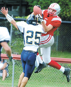 jhcawaynefb2 - Connor Henderson comes up with a second quarter reception for a touchdown as he makes the catch over Wayne defender Blake Decosta on a pass from Justin Tomzak.