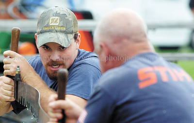 jhlumberjack1 - Kolby Liebenguth of Macedon is all concentration as he and partner Marty Dodge put in their effort in the Crosscut Saw competition on Saturdya at the 24th Annual Macedon Center Community Lubmerjack Festival on Saturday. Some events will continue on Sunday.