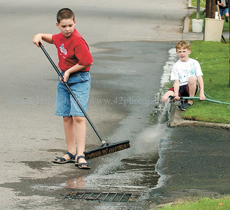 jhstreetcleaners - Bradley Gellatly, 9, and Mason Smith, 9 of Palmyra do a little street cleaning on Saturday along Cuyler Street on Saturday as the town celebrated its Canaltown Days.