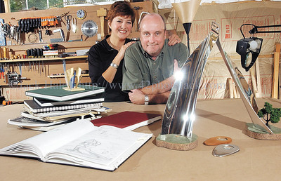 jhsculptors - Mark and Diane Weisbeck are in Mark's studio along with the tools of the trade, sketchbooks and scaled down models of some of his creations.