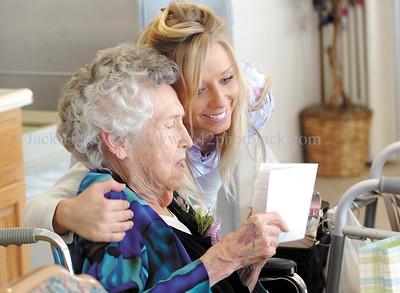 jhjoblinn1 - Jo Blinn gets a birthday hug from Emily Featherly of Shortsville, a nursing assistaint at the Ontario County Health Facility, on her 100th birthday, Wednesday, February 7, 2007.