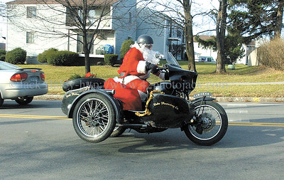 jhcyclesanta2 - Mike Dube of Palmyra plays Santa and delivers presents aboard his motorcycle complete with sidecar. He will be delivering to the VA on Christmas Day.