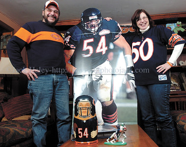 jhbearsfans1 - Gary and Bette Collier of Phelps are huge Chicago Bears fans complete with a six foot cutoutl of Brian Urlacher. The only disagreement about the two on Super Bowl Sunday is who's better Urlacher  (Gary's Choice) or former linebacker Mike Siingletary (Bette's choice).