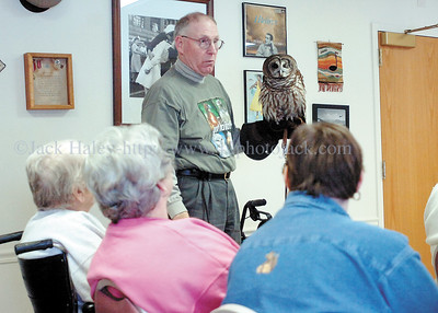jhraptor2  - Ron Walker of Friends with Feathers talks about the Barred Owl he is holding at Horizons on Friday. Walker brought three birds to show the residents. All the birds at his aviary have injuries that would not let them survive in the wild.