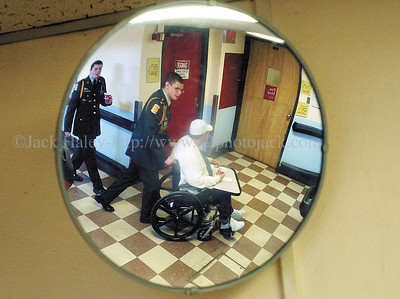 jhROTC2 - Reflected in a hallway mirror, John Marshall students Patrick Hoffman (left) and Josh Arpon return a  VA resident back to his room after enjoying donut and coffee's.