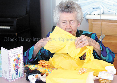 jhjoblinn2 - Jo Blinn opens presents given to her by friends at the Ontario County Health Facility to celebrate her 100th birthday on Wednesday, February 7, 2007. Later that day they would have birthday cake brought in by her granddaughter.