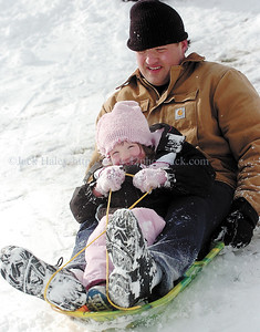 jhsled1 - Joel Jeneqult and his daughter Jillian 4, team up for a sled ride on Saturday (1/20) at Baker Park iin Canandaigua.