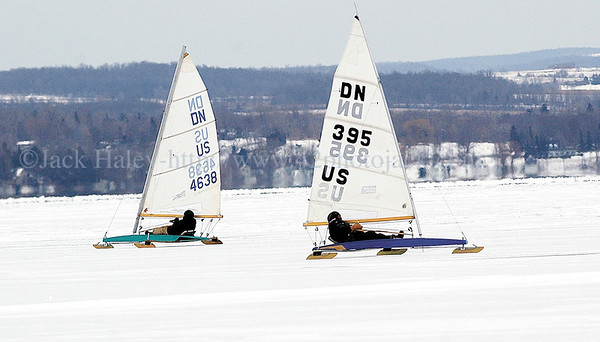 jhiceboats2 - Jack Harrison (left) of Honeoye and Don Schenkel of Canadice cross past each other on Tuesday. Along with Steven Pearson the trio were ice boating on Canandaigua Lake on Tuesday, hoping to get a little action in before Wednesday predicted storm.