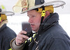 jhdrill4 - Captain Sam Loiacono answers a radio call from interior attack team that the fire is under control.