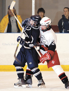 jhcapitthock - Canandaigua's Tony Liberti and Pittsford's Stu Wilson tangle up in the first period of the championships game of the Canandaigua Tournament on Saturday,