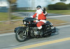 jhcyclesanta1 - Mike Dube of Palmyra plays Santa and delivers presents aboard his motorcycle complete with sidecar. He will be delivering to the VA on Christmas Day.
