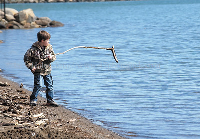 jhlakeshore - Dominick Morey, 6, of Canandaigua plays along the shore of Canandaigua Lake on Saturday, 3/31.