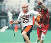 jhhobartrutgers1 -  	CHRIS OÕDOUGHERTY Chris O'Dougherty of Rutgers knocks the ball loose from Hobart's Nick Currie during the Scarlet Knights win over the host Statesmen in double overtime 12-11.