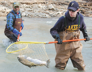 jhshocking5 - Eric Olsowsky carries the then lunker fish (7.2 pounds) back to the holding net as his father Dave Olsowsky watches.