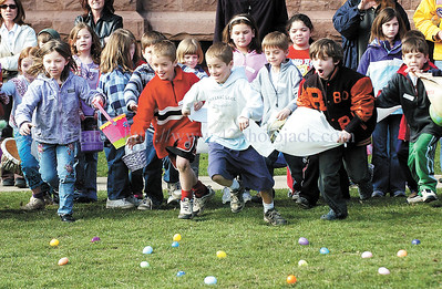 jhegghunt2 - Youngster head off the start line to scoop up plastic eggs at the Easter Egg Hunt at St. Mary's on Saturday 3/31.