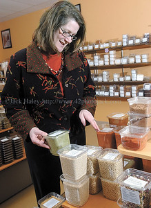 jhspice2 - Michelle Jones Ham owner of Canandaigua Spice Company stock shelfs at her store in Parkway Plaza.
