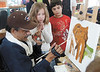 jhartists1 - Sarah Mottshaw and Hayyan Altawel, students at Walt disney elementary School in Gates, look on as artist  Renee Rodriequez works on an elephant he is painting as part ofa broogram from the Multiple Sclerosis Achievement Center