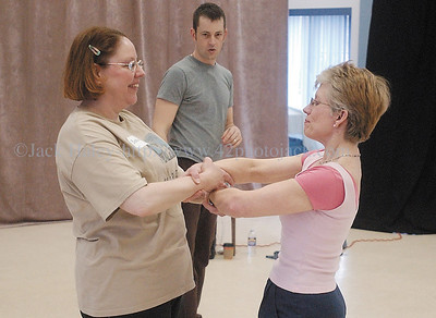 jhpush3 - Darren Stevenson watches as Bernie Van Epps (left) of Canandaigua and Gail Wiechmann of Bristol work on a exercise from the workshop given by PUSH Physical Theatre on Saturday (3/24) The workshop was followed by a performance from Stevenson and his wife Heather.