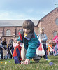 jhegghunt1 - Nikos Soklaropoulos,4, of Bloomfield picks up a plastic egg during an Easter egg hunt at St. Mary School on Saturday, 3/31;.