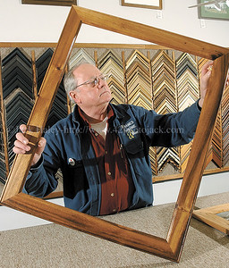 jhframes - Clifton Springs resident Bill Kranz checks a joiint on a Rain Tree Wood frame (variant of mahogany), a wood he specializes iin and works with by hand at his Frames Galore & More Inc. shop in the village of Penn Yan.