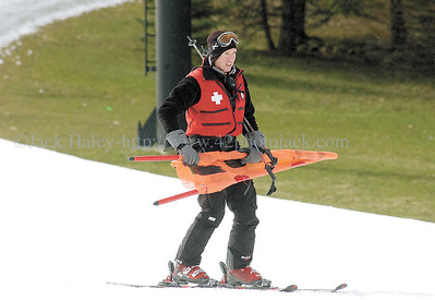 jhbristoldone1 - Scott Mundrick of Canandaigua, a member of the Ski Patrol at Bristol Mountain comes down with a warning sign/flag to slow skiers down at the bottom of the slope as the reported final day of sking concluded on Saturday (April 7).