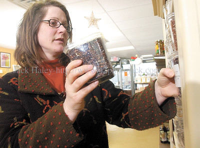 jhspice1 - Michelle Jones Ham owner of Canandaigua Spice Company stock shelfs at her store in Parkway Plaza.