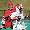 jhhobfairlax1 - Chris Ajemian of Fairfield can't get the stick of Hobart's Sean Murphy durinig first-half actio of the host Statesmen's 11-10 win over the Stag's.