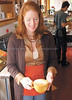 jhstarbuckshere3 - Veronica Morgan, an employee from the opening of Phoenix Coffee carries out a latte made by Corey Jones on Wednesday.