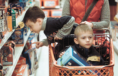 jhhillside1 - Ben Guisto spots something of interest as he and Max Reagan ride around in a cart pushed by Ben's mother ellen guisto as Allendale Columbia kindergartners went shopping at Target in Victor on Wednesday, December 12 for children at the Hillside Children's Center.