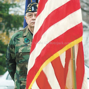 jhvet3 - Sgt. of Arms Ted Fafinski stands at attention after lowering the flag to half mass  during Veteran Day ceremonies.