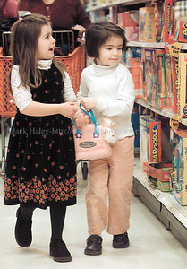 jhhillside2 - Cassidy Draper (left) and Ann Margaret Mealey walk together down a toy isle at Target on Wednesday (12/12) as they along with other Allendale Columbia kindergartners went shopping for Hillside Children's Center children after the youngsters racised  money from a bake sale.